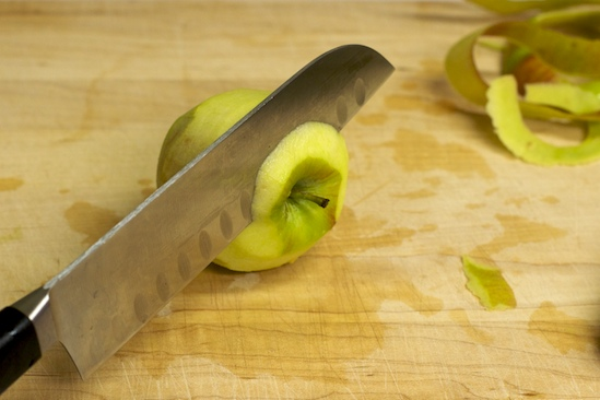 Next, cut a thin slice off the top of the apple.
