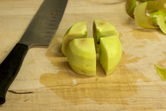 Now cut the apple into four quarters. I like to do this with the apple turned upside down.