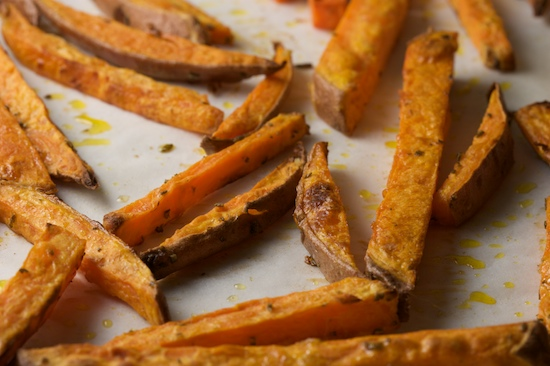 Roast the sweet potato fries in a 425 degree oven for 30-35 minutes, or until golden brown.  Check them every ten minutes, and stir or turn them if they appear to be getting dark on the bottom. Watch carefully towards the end because they can burn quickly!