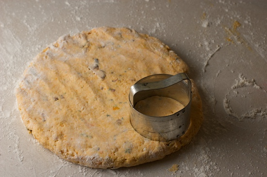 With your hands, gently pat the dough out into a circle, about 1/2 inch thick.