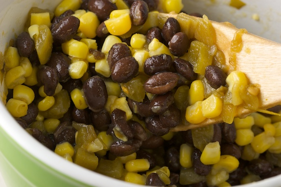 In a small bowl, stir together the black beans, corn, and canned green chiles.