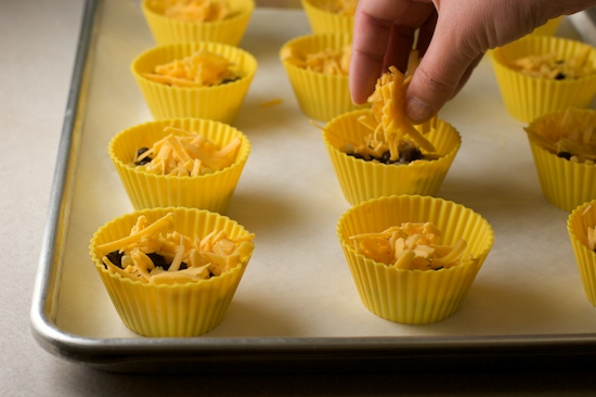 Divide the shredded cheese between the muffin cups. I wanted to use pepper jack, but realized at the last minute I only had cheddar. I still pepper jack will taste better!