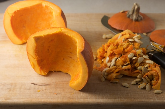 Cut the pumpkin in half and scrape out the insides. Save the seeds for roasting if you're into that kind of thing!