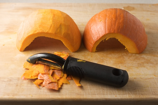 I find that a vegetable peeler works very well for peeling pumpkins (and butternut squash).