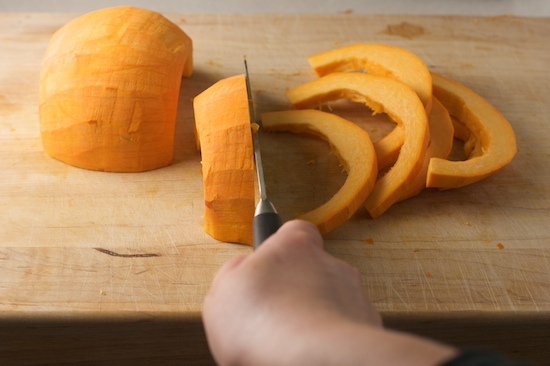Cut the pumpkin into slices that are between 1/4 and 1/2 inch thick. They don't have to be perfectly uniform.