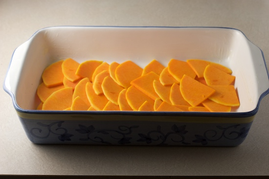 Use half of the butternut squash slices to form a single overlapping layer in the bottom of a greased 9x13 casserole dish (or use a similar sized gratin dish).