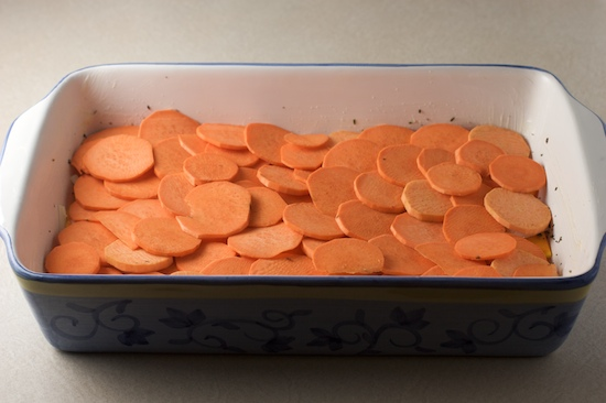 Now use half of the sliced sweet potatoes to form another single overlapping layer.