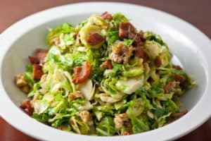 Shredded brussels sprouts with bacon and walnuts make a perfect, healthy, and seasonal fall side dish | pinchmysalt.com