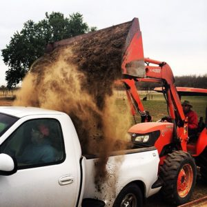 Picking up dirt from the ranch