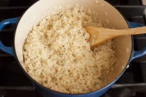Sautéing rice for Green Chile Rice | pinchmysalt.com