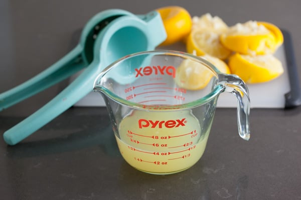 Squeezing fresh lemon juice for Lemon Cream Pie | pinchmysalt.com