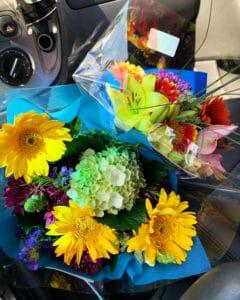 CA GROWN flower bouquets in my car