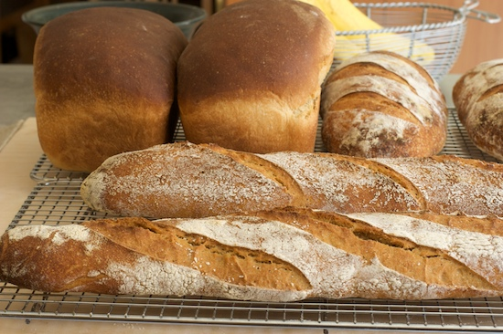 Loaves of sourdough and whole wheat bread