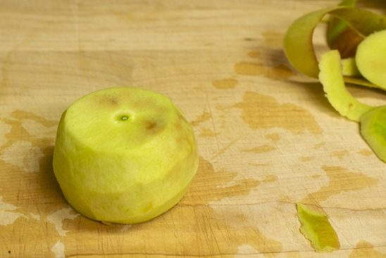 The apple will now sit steady on the cutting board to make it easier to section, and remove the core.