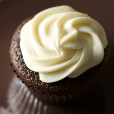 Vanilla Bean Cream Cheese Frosting on top of a Chocolate Stout Cupcake