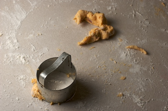 Combine scraps of dough to cut an extra biscuit or two. The final scraps can be shaped to form an extra tiny biscuit.