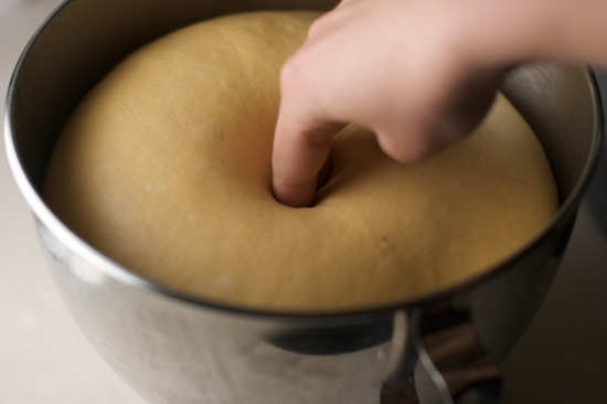 To check if dough has doubled, push your finger into the dough. If the indentation remains, it's ready to go!