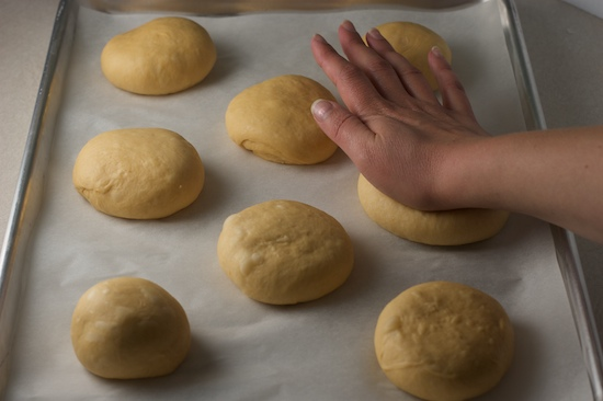 Place rolls on parchment-lined baking sheet and flatten slightly with the palm of your hand.