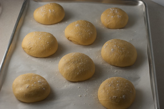 After they have risen, dust lightly with flour then place in preheated 375 degree oven.
