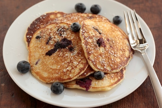 Blueberry Orange Cornmeal Pancakes on White Plate