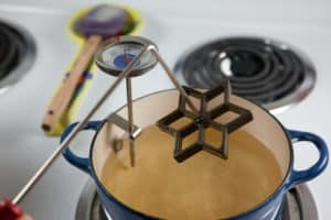 Pulling Rosette Iron from Oil