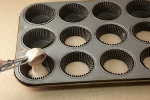 Adding Bottom Layer of Muffin Batter