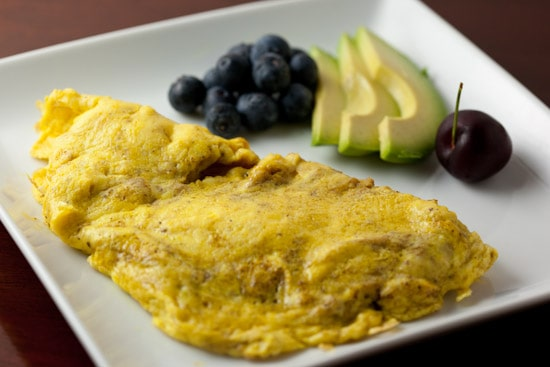 Curried Scrambled Eggs with Avocado and Fruit