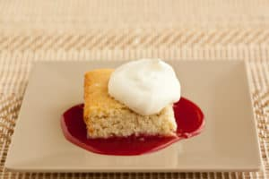 Coconut Bar with Cherry Sauce and Whipped Cream