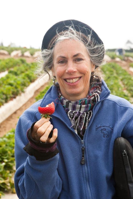 Jill a.k.a. The Veggie Queen enjoying a strawberry