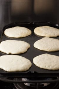 Buttermilk Sourdough Pancakes on the griddle | pinchmysalt.com