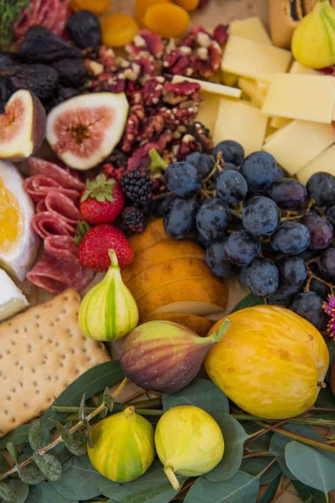 Grazing board filled with California fruits, vegetables, nuts, and cheese.