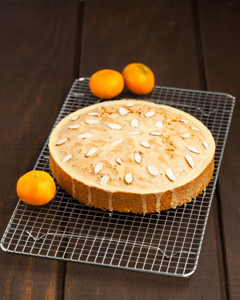 Citrus almond olive oil cake topped with citrus olive oil glaze and sliced almonds